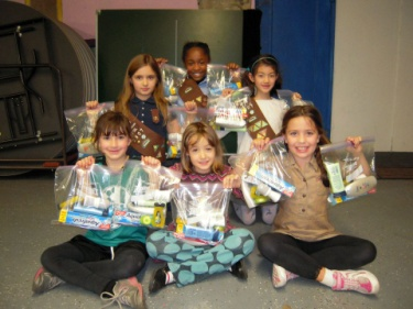 Brownie Troop 2307 in Brooklyn assembled and delivered hygiene kits for their local Veterans Evacuation Center.
